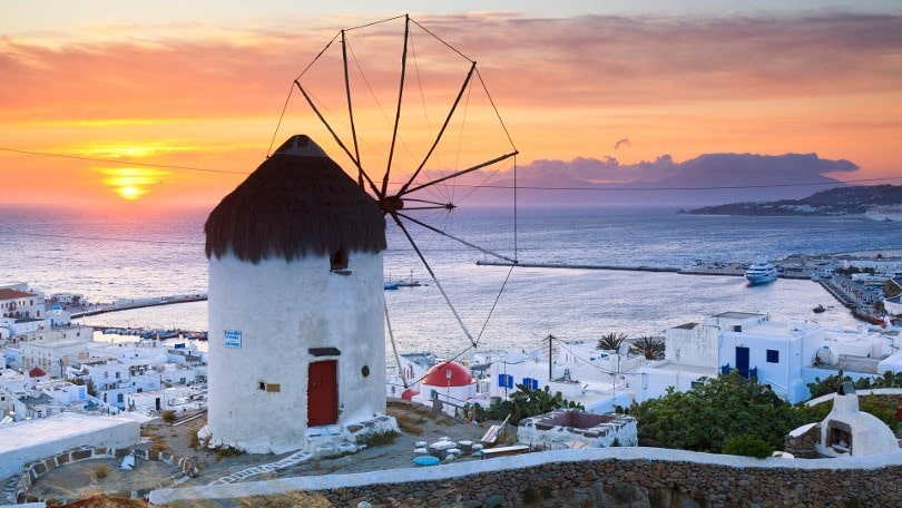 10 May 2011, Mykonos Town, Mykonos, Greece --- Windmill Overlooking Mykonos Town At Sunset. --- Image By © Frank Lukasseck/Corbis